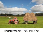 Tractor With A Load Of Hay Bales