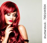 glamorous redhead woman with... | Shutterstock . vector #700144504