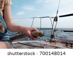 caucasian woman holding... | Shutterstock . vector #700148014