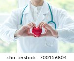 cardiologist doctor holding red ... | Shutterstock . vector #700156804