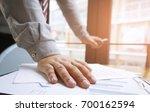 hands of business people... | Shutterstock . vector #700162594