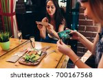 young female food bloggers... | Shutterstock . vector #700167568