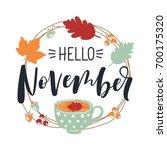hello november. autumn leaves... | Shutterstock .eps vector #700175320
