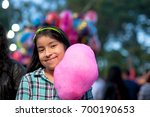smiling girl holding a cotton... | Shutterstock . vector #700190653