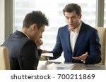 angry mean boss yelling at... | Shutterstock . vector #700211869