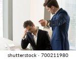 angry boss dismissing... | Shutterstock . vector #700211980