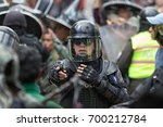 Small photo of June 24, 2017 Cotacachi, Ecuador: riot police sorting out an altercation during the Inti Raymi parade