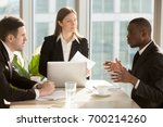 multi ethnic business team... | Shutterstock . vector #700214260
