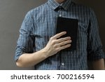 a man holding a bible and pray  ... | Shutterstock . vector #700216594
