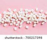 marshmallows on pink background ... | Shutterstock . vector #700217398
