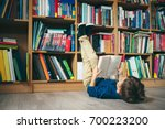 boy laying on the floor with... | Shutterstock . vector #700223200