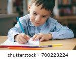 close up  cute  boy doing...   Shutterstock . vector #700223224