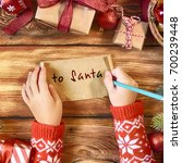 childs hands with letter to... | Shutterstock . vector #700239448