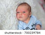 little newborn baby looking ... | Shutterstock . vector #700239784