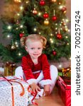 little baby girl with santa hat ... | Shutterstock . vector #700257424