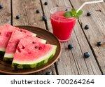 watermelon juice on a wooden... | Shutterstock . vector #700264264