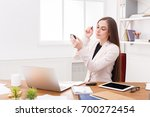 young business woman refreshing ... | Shutterstock . vector #700272454