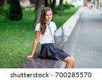 a girl in school uniform on a... | Shutterstock . vector #700285570