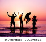 silhouettes of happy friends... | Shutterstock . vector #700295518