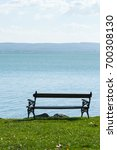 Small photo of lakeside bench at october indian summer