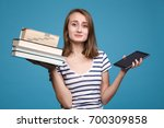 book vs e book. girl student...   Shutterstock . vector #700309858