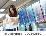 asian woman information board... | Shutterstock . vector #700343860