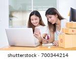 freelancer asian women teamwork ... | Shutterstock . vector #700344214