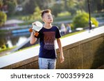 a teenager in sunglasses skates ... | Shutterstock . vector #700359928