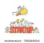 cartoon working little people... | Shutterstock .eps vector #700364014