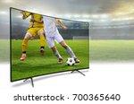 4k monitor watching smart tv... | Shutterstock . vector #700365640
