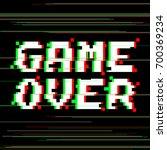 vector game over phrase in...   Shutterstock .eps vector #700369234