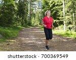 active senior woman exercising. ... | Shutterstock . vector #700369549