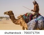 bedouin men riding the camels... | Shutterstock . vector #700371754