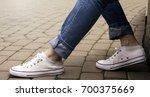 woman in sneakers on the street ...   Shutterstock . vector #700375669