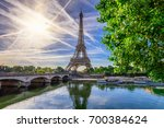 paris eiffel tower and river... | Shutterstock . vector #700384624