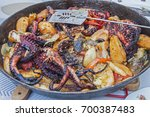 seafood grilled octopus with... | Shutterstock . vector #700387483