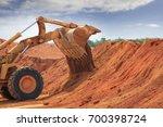 a huge bulldozer at weipa... | Shutterstock . vector #700398724