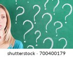 pensive woman with question... | Shutterstock . vector #700400179