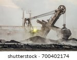 big bucket excavator works in a ... | Shutterstock . vector #700402174