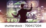 back view of businesswoman...   Shutterstock . vector #700417204