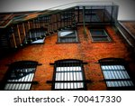 fire escape on an old brick... | Shutterstock . vector #700417330