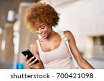 african american woman checking ... | Shutterstock . vector #700421098