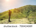 young man asian photographers... | Shutterstock . vector #700424089