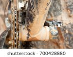 mud dirty chainring and chain... | Shutterstock . vector #700428880