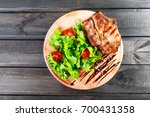 grilled pork chop steak with... | Shutterstock . vector #700431358