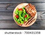 grilled pork chop steak with... | Shutterstock . vector #700431358