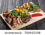 assorted delicious grilled meat ... | Shutterstock . vector #700432108