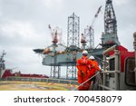 technician or worker on the job ... | Shutterstock . vector #700458079