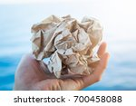 hand with old peper recycle... | Shutterstock . vector #700458088