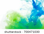 colors dropped into liquid and...   Shutterstock . vector #700471030